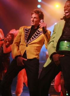 Barry Manilow and Kye Brackett doing the crotch grab during Copacabana LV Hilton.