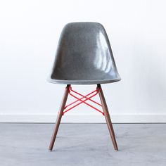 C+C Eames DSW Gray Red by Charles and Ray Eames