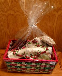 Poinsettia basket includes table runner, napkins, towels, plate and candle holder.