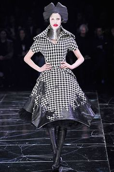 My favorite designer- Alexander McQueen. Plus I LOVE houndstooth. I'd definitely wear this dress! Different heels, jewelry and makeup though. Haha!