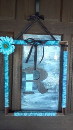 Pinterest Inspired Picture Frame Wreath!  Goodwill frame~ $1.50  Yarn~ $2.00  Letter~ $2.50  Sand paper, Ribbon & Spray paint~ leftovers  Flower~ salvaged from a purse         READY FOR SPRING!!