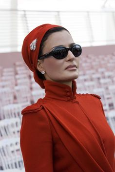 Hands down! Sheikha Mozah is looking beyond elegant in Jean Paul Gaultier couture at the Bastille Day parade in Paris in 2007. This couture was from the Fall 2007 collection, the shoulders and collar have military influence which was perfect for the occasion. She accessorized with simple diamond earrings and diamond brooch on the turban. Photo from HHOPL.