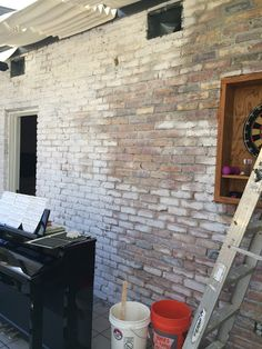 Hate the color of your brick? Try staining it. I stained the front ...