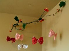 a kids craft winner, for sure will be trying this tissue paper butterflies mobile hanging from a tree branch.