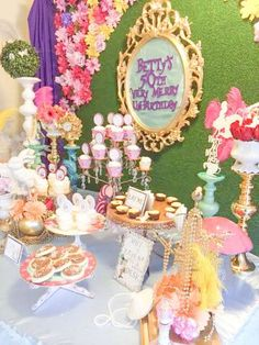 Pretty dessert table at an Alice in Wonderland birthday party! See more party planning ideas at CatchMyParty.com!