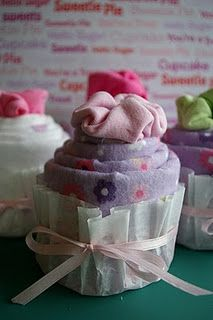 Baby Onesie Cupcakes: 4 receiving blankets, 4 onesies, 4 rubber bands, 4 coffee filters, & ribbon.
