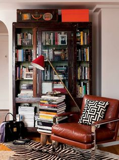 Since Nate Berkus established his award winning interior design firm at the age of his approachable and elevated philosophy has transformed countless Library Bookshelves, Bookshelves In Living Room, Cozy Living Rooms, Living Room Decor, Bookcases, Dining Rooms, Dining Chairs, Nate Berkus, Coffee Table Design
