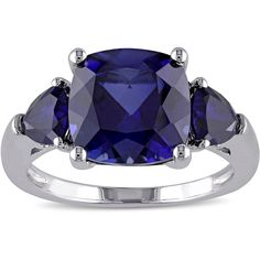 Miadora Sterling Silver Created Blue Sapphire Cocktail Ring ($58) ❤ liked on Polyvore featuring jewelry, rings, blue, blue sapphire ring, wide sterling silver rings, long rings, cocktail rings and three stone ring