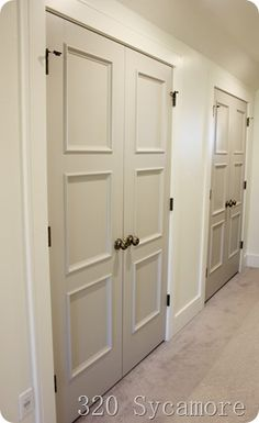 gray doors in hall Grey Doors, Parade Of Homes, Mudroom, Armoire, Tall Cabinet Storage, Paint Colors, Beautiful Homes, Gray, Furniture