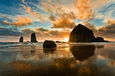 Cannon Beach, Oregon -- Set alongside Ecola State Park, this beach offers incredible views, lovely hikes and it's a bit less crowded in the fall. The town is a popular vacation resort that extends for four miles along the Pacific Ocean. You'll also enjoy odd rock formations, stunning coastline, unique lodgings, and scenic trails. Cannon Beach is also one of the most pet-friendly destinations to which you can take your four-legged best friend. - Shutterstock