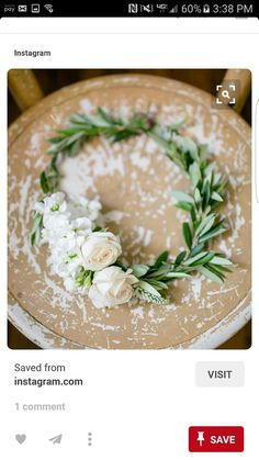wreaths of greenery with a cluster of blooms, for the flower girls