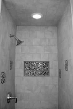 Bathroom and shower done by Bob Hume and RGH Development Company.  Accents in the tile work brings out the beauty and design in this bathroom.