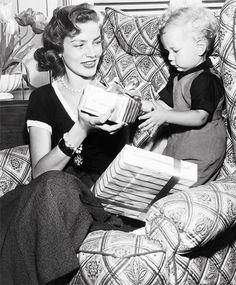 Lauren Bacall hands her son, Stephen Bogart, a gift, Christmas 1950.