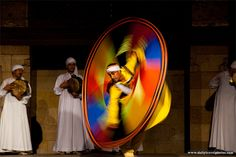 Whirling dervish performance in old Islamic Cairo twisting in technicolor