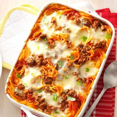 Favorite Baked Spaghetti Recipe -This yummy spaghetti casserole will be requested again and again for potlucks and family gatherings. It's especially popular with my grandchildren, who just love all the cheese. —Louise Miller, Westminster, Maryland