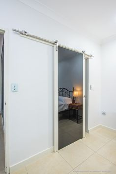 Top hung sliding door showing a closer view of the pelmet for Top hung sliding glass doors