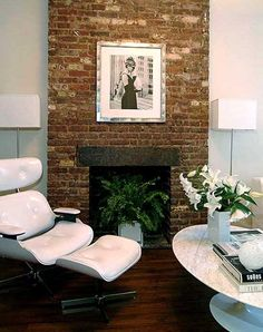 Eames chair, breakfast at Tiffany. love a brick chimney breast.