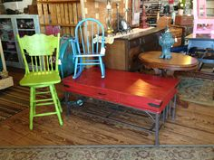 Stool in Home Turf, rocker, and coffee table in Fireworks Red.