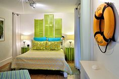 Creative island bedroom features reclaimed bamboo and recycled wooden shutters painted green. A perfect compliment to the hand hewed platform bed. Key West Rentals, Key West Vacations, Painting Shutters, Places To Rent, Wooden Shutters, Vacation Villas, Platform Bed, My Dream Home, Beach House