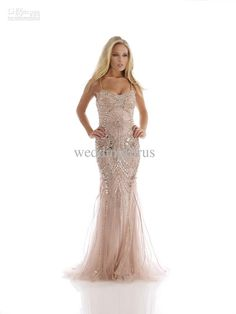 4099d678ed1b All eyes will be on you when you waltz in wearing this fabulous formal gown  by Morrell Maxie This dress has spaghetti straps and ornate stones  throughout
