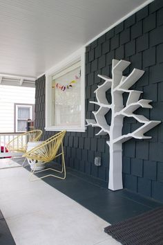 Front Porch.  Black Shingled Craftsman Mixes Up With Modern.  Acapulco Chairs.  Chinese Garden Stool.  Tree Scuplture.