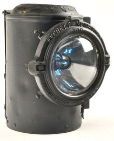 """Semaphore lamp retrofitted to electrical with Everett conversion kit. Railroad service conversion has all original holes in lamp sealed and bolt-on eletric light affixed over original lens hole. Cord is not attached. Marked N&W on tag at top. size: 10"""" t."""