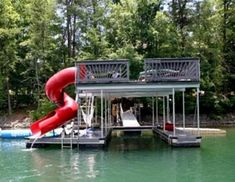 Host a friendly summer gathering or relax in the sun on the upper level of this two-slip boat dock. Have a splash on the attached slide or patter around on the water toys for a fun afternoon at the lake. Lake Dock, Boat Dock, Floating Dock, Lakefront Property, D House, Lake Cabins, Lake George, River House, Lake Life