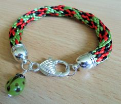 Kumihimo bracelet in ladybird design by CoastalMoonJewellery on Etsy