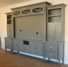Image result for family room with large painted entertainment center