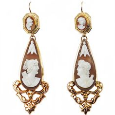 19th Century Cameo Earrings. A pair of antique yellow gold earrings with four shell cameos depicting classical deities. Circa 1840