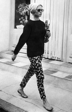 Buzzfeed. Brigitte Bardot walking down the streets in dot print pants, sweater, ballerinas, sunnies, and a handkerchief in her head