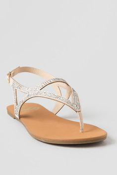 The Carlie Sparkle Sandal is your summer staple. These sandals feature a  nude upper adorned with embellishments and an adjustable ankle strap.