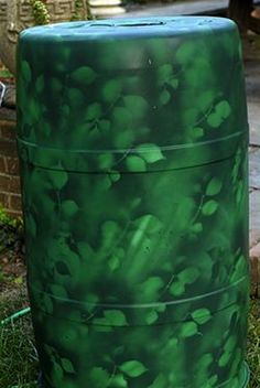 How to paint a plastic rain barrel. Or in my case an ink barrel that is just plain black. It is used for a big trash can for the pool parties we host. Have always wanted to add a monogram or something to dress it up. Rain Barrel Kit, Water Barrel, Rain Barrels, Spray Paint Plastic, Rain Collection, Rainwater Harvesting, Fish Ponds, Garden Pond, Garden Fountains