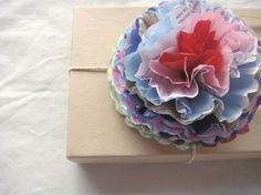 gorgeous recycled paper flowers for gifts or decoration.