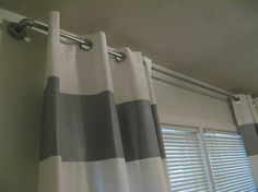 Industrial Look Curtain Rods with grommet curtains (metal rings in fabric)