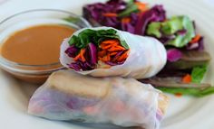 Spring Rolls  Makes 15 spring rolls 15 round rice paper wrappers    enoki mushrooms  carrot, grated lengthwise zucchini, julienned  purple cabbage, chopped ½ cup olive or grape seed oil 1 T minced garlic 1 T peanut butter 1 Tbsp. lemon juice Fresh cilantro and/or basil  3 T soy sauce 2-3 T sriracha sauce Salt and pepper to taste