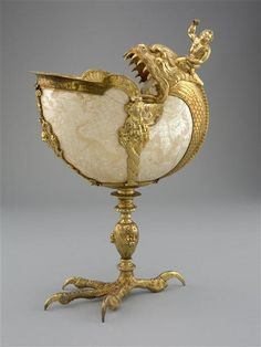 Standing cup with nautilus shell carved in China in the late to early century. The silver-gilt mounts, with Hercules astride a sea monster and a naturalistic eagle& foot, were added to the shell in Italy or Germany, Concha Nautilus, Nautilus Shell, Shell Decorations, Art Ancien, Shell Ornaments, Seashell Art, Sea Monsters, Ancient Artifacts, 16th Century