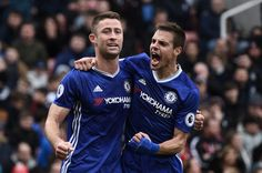 Chelsea's English defender Gary Cahill (L) celebrates with Chelsea's Spanish defender Cesar Azpilicueta after scoring their second goal during the English Premier League football match between Stoke City and Chelsea at the Bet365 Stadium in Stoke-on-Trent, central England on March 18, 2017. / AFP PHOTO / Oli SCARFF / RESTRICTED TO EDITORIAL USE. No use with unauthorized audio, video, data, fixture lists, club/league logos or 'live' services. Online in-match use limited to 75 images, no…