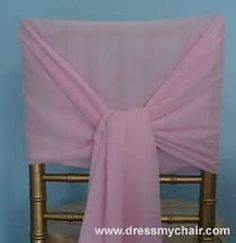 On top of the white chair covers, just use sashes to dress the chair up. If I could find a sash this wide it would be perfect! Could then add the ruffles!