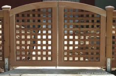 This arched lattice gate is wide enough for  wide objects or two people to pass through.