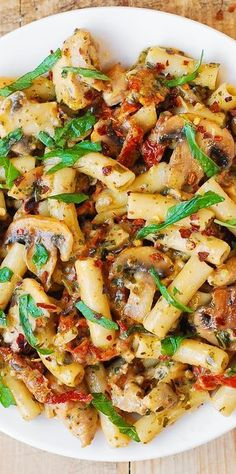 Mushroom Chicken Pasta with creamy Pesto sauce and sun-dried tomatoes - Perfect Summer Recipe!