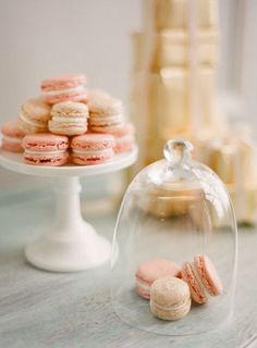 French macrons ready for guests and displayed perfectly on a cake stand.
