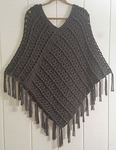 This cozy, fringed poncho works up fast with bulky weight (size 5) yarn and a Size N – 9mm crochet hook. Front and back post double crochet and shell stitches create a beautiful cable texture. The poncho is crocheted in two large rectangles that are sewn together. The neckline is edged with single crochet and the 6-inch fringe tassels are simply knotted along the edges. The yarn used in this project is Big Twist Chunky, available at Joann stores.