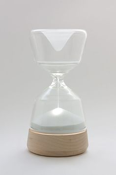 "hourglass lamp ""night night"" by vanessa hordies: the sand within covers the light, and it gradually drown out the luminosity of the bedroom."