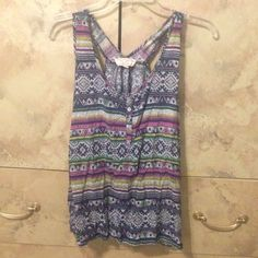 Tribal print tank top Tank top with buttons in front of short and colorful designs on it. Worn once and in greet condition. Reasonable offers considered  Pink Rose Tops Tank Tops