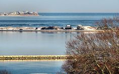 On top of Burial Hill in Plymouth, MA, you have this view of the harbor, jetty, beach, bay and open sea. - Janice Drew