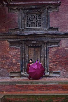 Umbrella Kathmandu, Nepal. How beautiful the contrasting of colors are, what a lovely photo