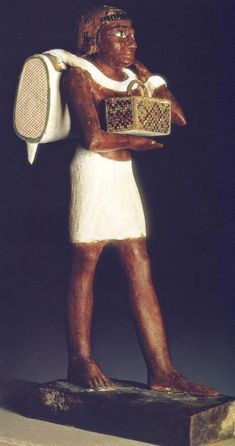 *EGYPT ~ Side view of the carrier of the backpack. DAMIANO, old Egypt. The splendor of the Pharaohs, Madrid, p.