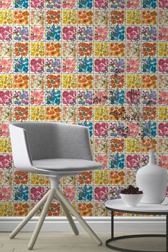 A raised tiled Albany wallpaper design with colourful blooms and butterflies presented in each tile.