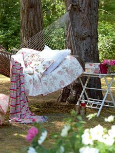 Look at this adorable hammock setting - it looks like an outdoor bedroom!